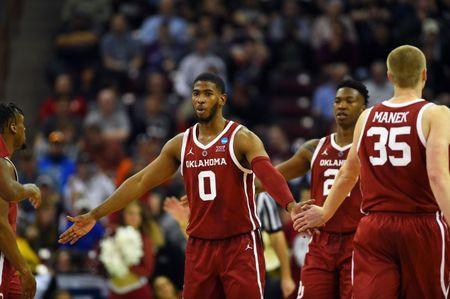 Mar 22, 2019; Columbia, SC, USA; Oklahoma Sooners guard Christian James (0) celebrates with teammate during the second half against the Mississippi Rebels in the first round of the 2019 NCAA Tournament at Colonial Life Arena. Mandatory Credit: Bob Donnan-USA TODAY Sports