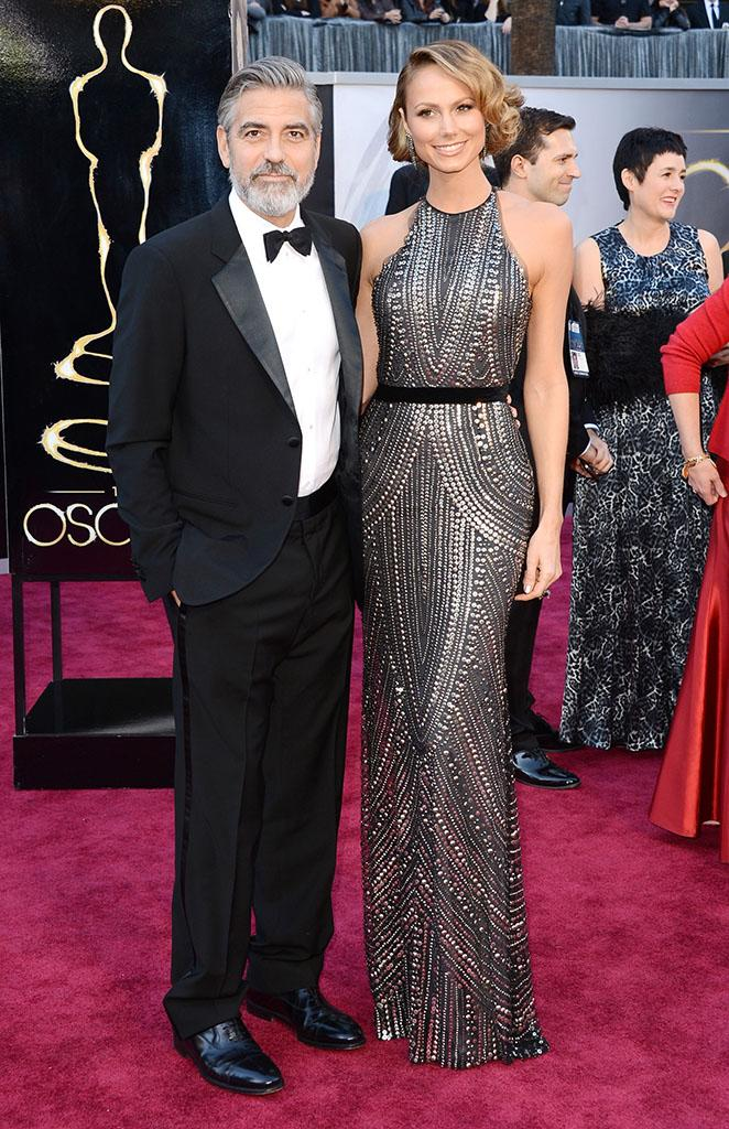 George Clooney and Stacy Keibler arrive at the Oscars in Hollywood, California, on February 24, 2013.