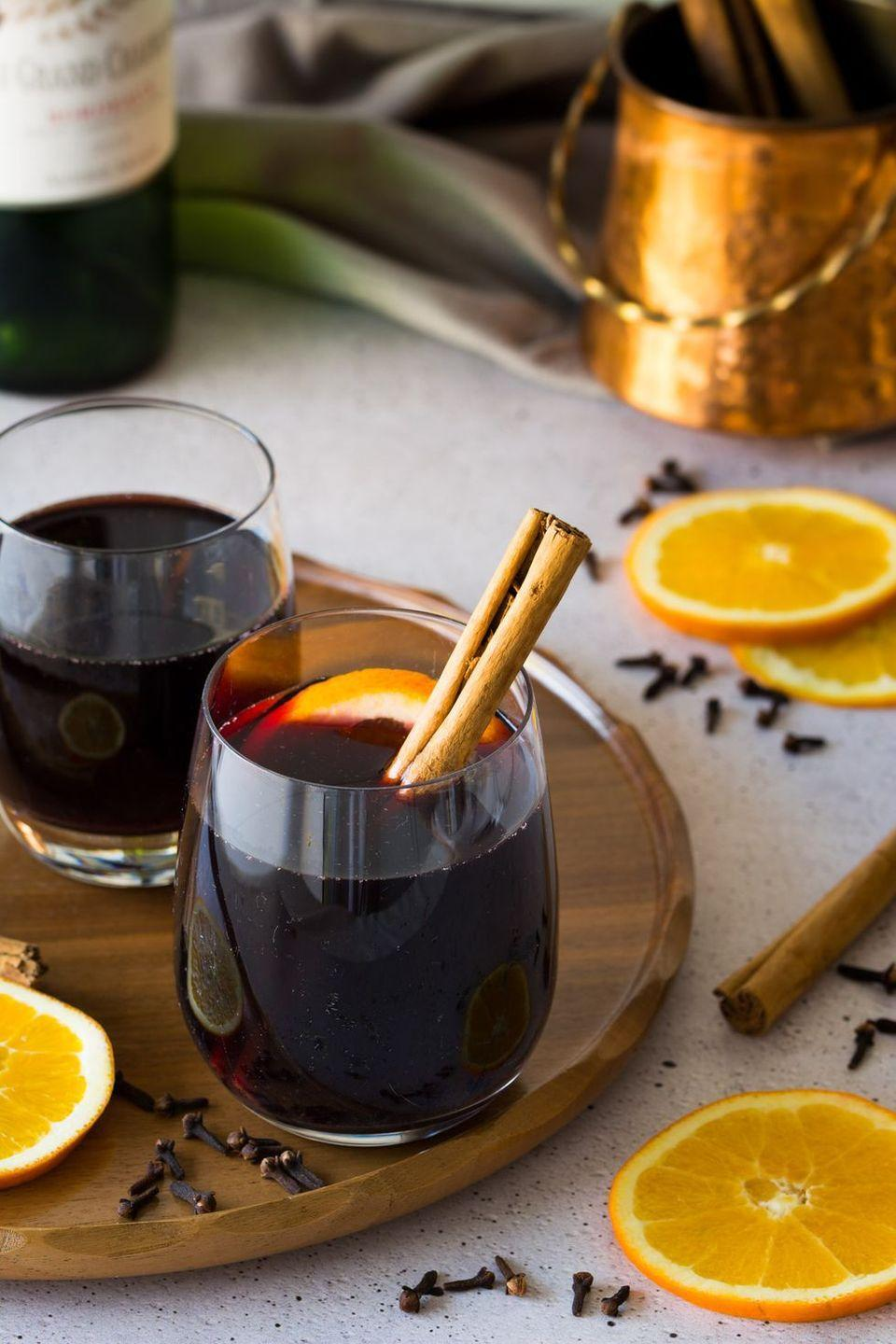 """<p>You don't have to travel to a European Christmas market to get traditional spiced wine. This hot beverage is easy to make in a big batch—perfect for a holiday party. <br></p><p><em>Get the recipe at <a href=""""http://laurencariscooks.com/christmas-market-style-gluhwein-mulled-wine/"""" rel=""""nofollow noopener"""" target=""""_blank"""" data-ylk=""""slk:Lauren Caris Cooks"""" class=""""link rapid-noclick-resp"""">Lauren Caris Cooks</a>.</em></p>"""
