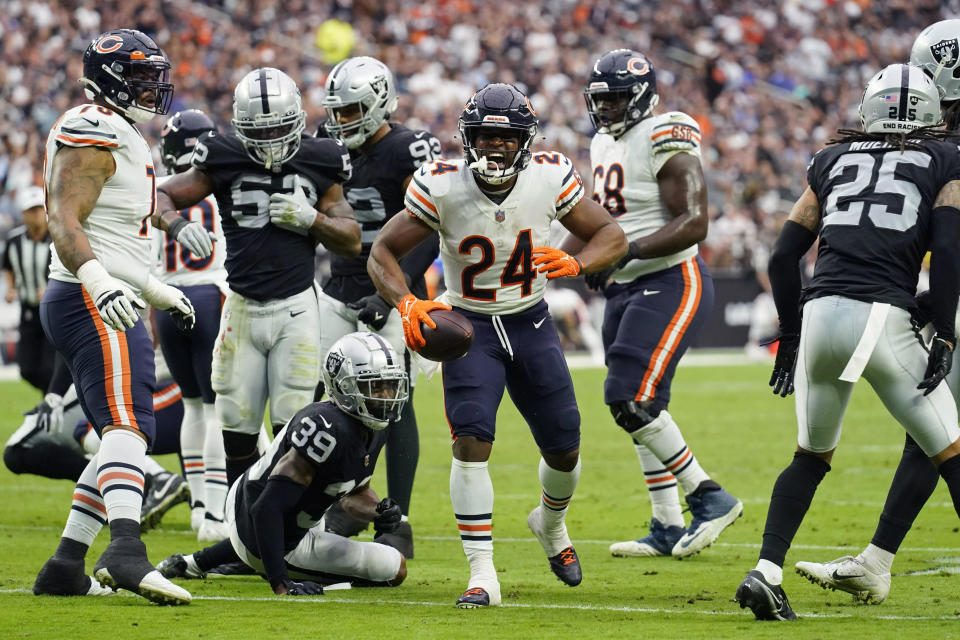 Chicago Bears running back Khalil Herbert (24) reacts after running for a gain against the Las Vegas Raiders during the first half of an NFL football game, Sunday, Oct. 10, 2021, in Las Vegas. (AP Photo/Rick Scuteri)