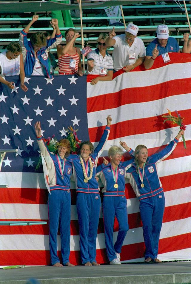 American swimmers, from left: Jenna Johnson; Dara Torres; Carrie Steinseifer, and Nancy Hogshead, stand in front of the American flag Tuesday July 31, 1984 after receiving gold medals in the women's 400-meter freestyle relay at the 1984 summer games.(AP Photo/Pete Leabo)