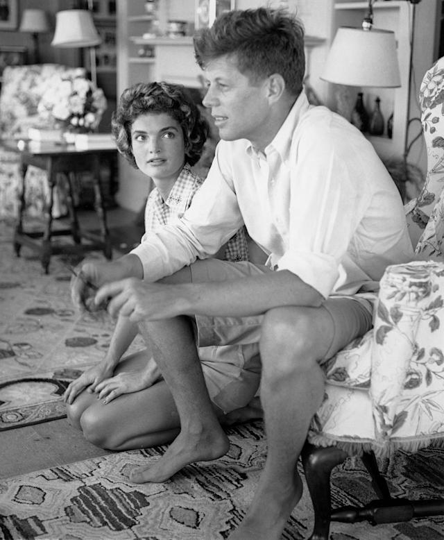 <p>Sen. John F. Kennedy and fiancée Jacqueline Bouvier are interviewed for a Life magazine story while on vacation at the Kennedy compound in June 1953 in Hyannis Port, Mass. (Photo: Hy Peskin/Getty Images) </p>