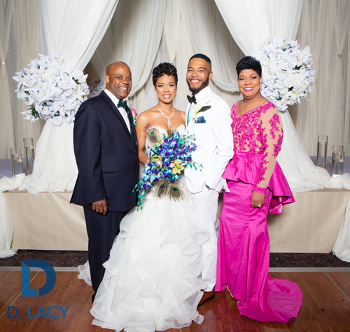 The bride and groom and her parents. (Photo: D. Lacy Weddings)