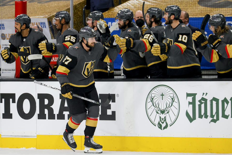 LAS VEGAS, NEVADA - JUNE 14:  Shea Theodore #27 of the Vegas Golden Knights is congratulated by his teammates after scoring a goal against the Montreal Canadiens during the first period in Game One of the Stanley Cup Semifinals during the 2021 Stanley Cup Playoffs at T-Mobile Arena on June 14, 2021 in Las Vegas, Nevada. (Photo by Ethan Miller/Getty Images)