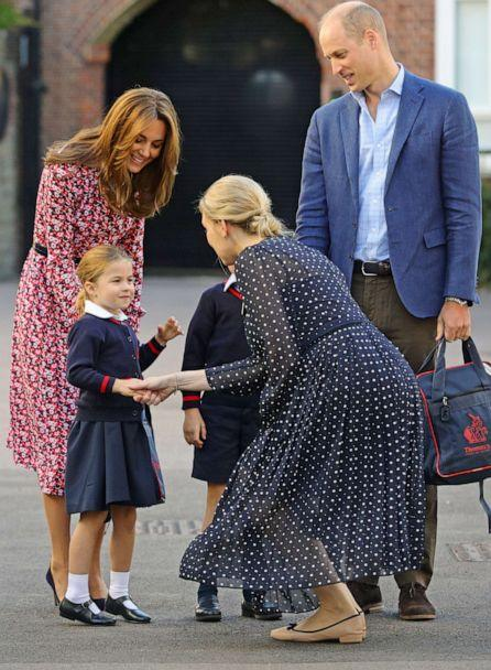 PHOTO:Helen Haslem, head of the lower school greets Princess Charlotte as she arrives for her first day of school, with her brother Prince George and her parents the Duke and Duchess of Cambridge, at Thomas's Battersea in London, Sept. 5, 2019, in London. (Aaron Chown/WPA Pool/Getty Images)