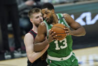 Boston Celtics' Tristan Thompson, right, drives against Cleveland Cavaliers' Dean Wade during the first half of an NBA basketball game Wednesday, May 12, 2021, in Cleveland. (AP Photo/Tony Dejak)
