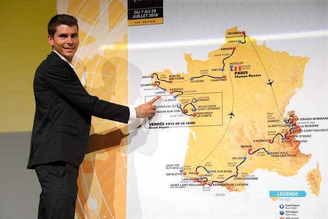 Rider Warren Barguil points at the map of the itinerary of the 2018 Tour de France cycling race during a news conference in Paris, France, October 17, 2017. The world's greatest cycling event will start from Noirmoutier-en-L'Ile on July 7 and will finish at the Champs Elysees in Paris on July 29. REUTERS/Charles Platiau