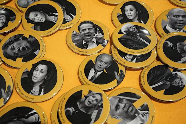 <p>Buttons of possible 2020 presidential contenders, including Sen. Bernie Sanders (I-VT), Sen. Elizabeth Warren (D-MA), Sen. Cory Booker (D-NJ), Sen. Kirsten Gillibrand (D-NY), Sen. Kamala Harris (D-CA), New York State Gov. Chris Cuomo and former Vice President Joseph Biden, are seen during CPAC 2018, Feb. 22, 2018 in National Harbor, Md. (Photo: Alex Wong/Getty Images) </p>
