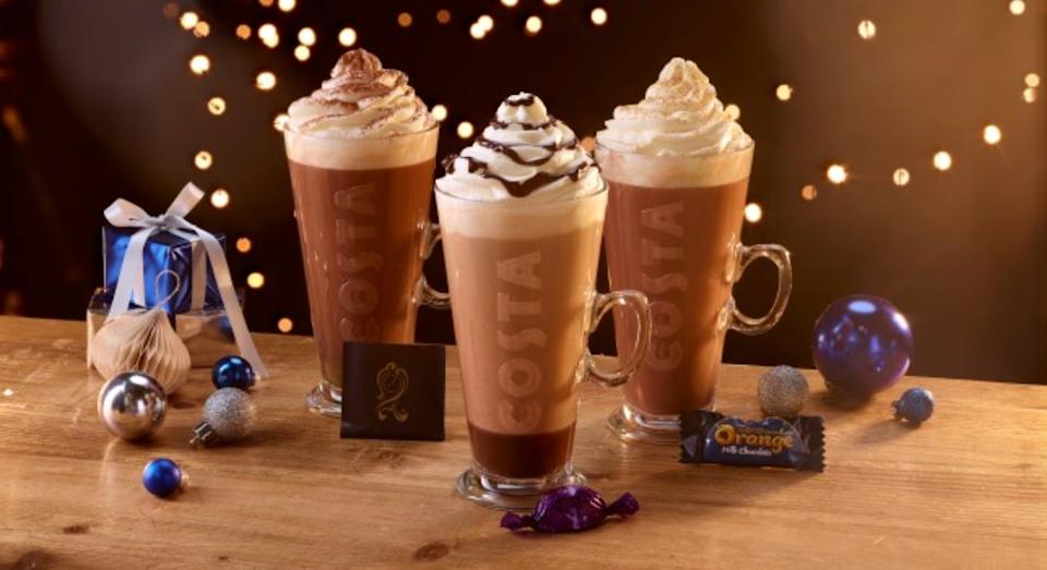 Costa has unveiled its Christmas drink range for 2020 including (L-R) After Eight hot chocolate, Quality Street Purple One latte and a Terry's Chocolate Orange hotel chocolate (Costa)