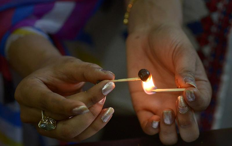In conservative Pakistan, an Islamic republic, the consumption of alcohol is strictly forbidden for Muslims but many are surprisingly open to using cannabis, with the spongy, black hash made from marijuana grown in the country's tribal belt (AFP Photo/ABDUL MAJEED)