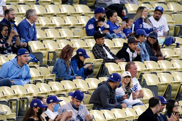 Baseball fans forgo masks as they watch the Miami Marlins play the Los Angeles Dodgers on May 14 in Los Angeles.