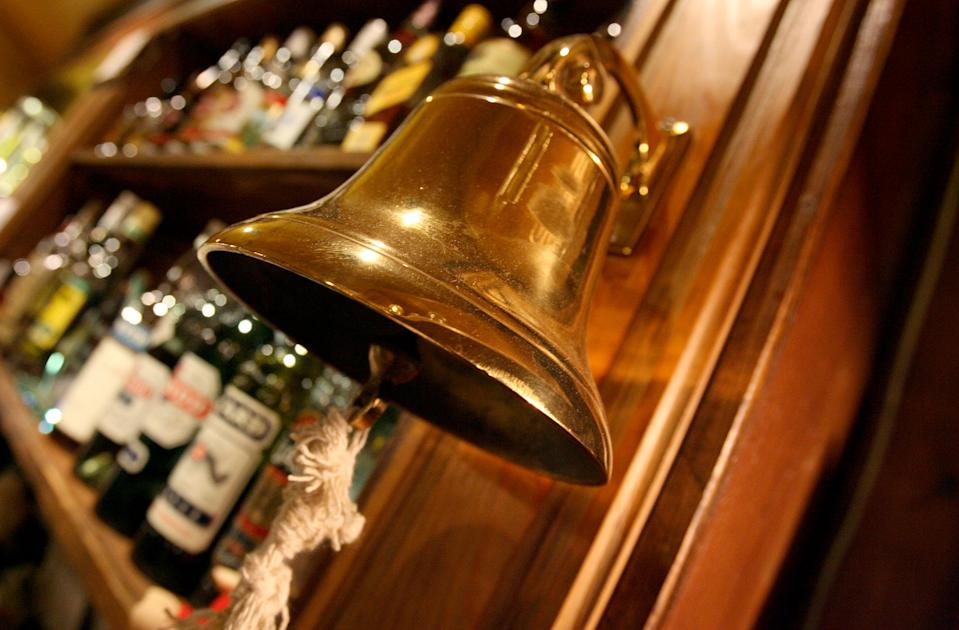 "A traditional ""last orders"" bell is seen behind the bar at The Speaker pub in Victoria, central London, November 23, 2005. About one third of all the pubs, clubs and shops in England and Wales licensed to sell alcohol will stay open for longer from midnight on Wednesday as Britain seeks a new way to tackle its binge drinking problem. Under new licensing laws, the country's pubs and bars will be allowed to stay open for longer and the fixed 11 p.m. closing time observed by most pubs since World War One will be swept away. CPROD REUTERS/Toby Melville"