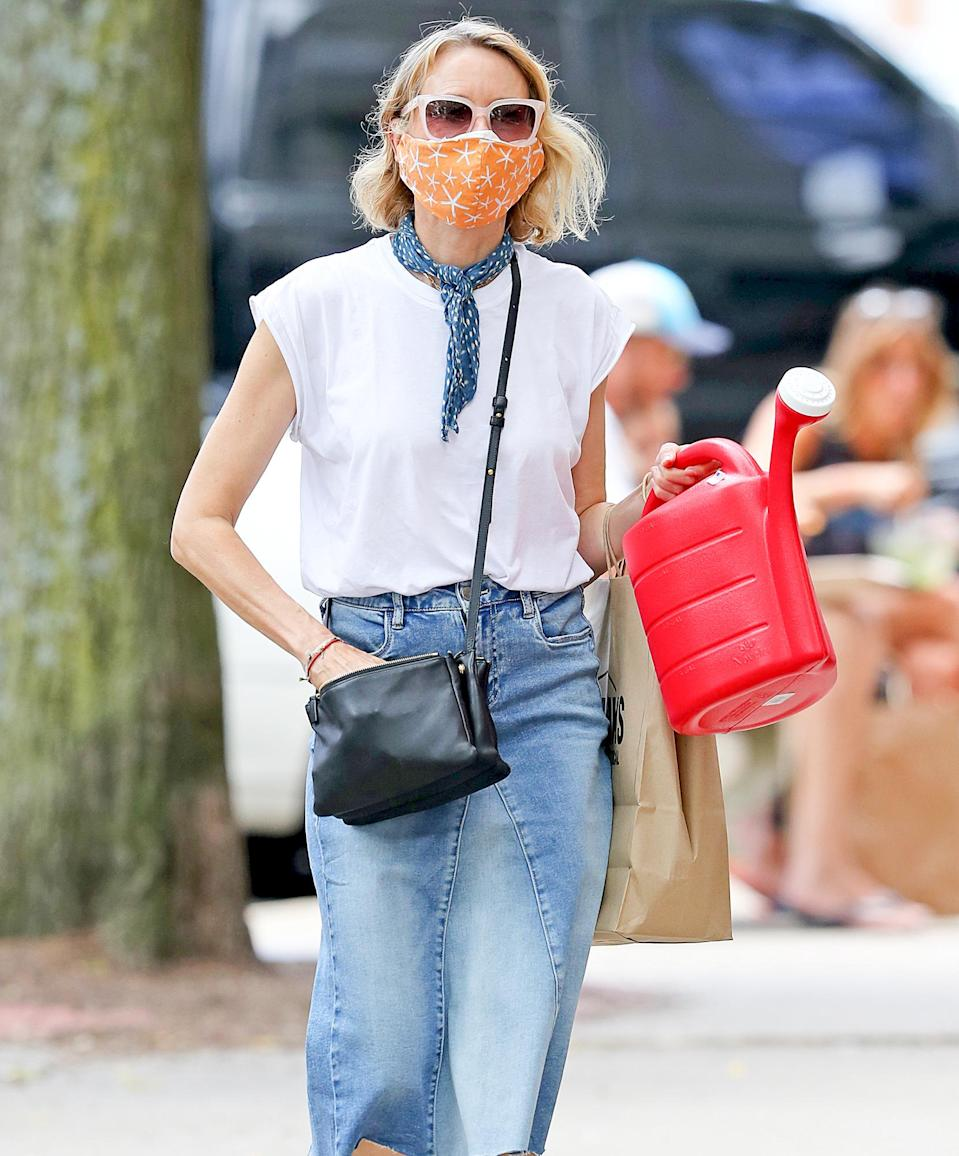 <p>Naomi Watts grabs some gardening gear on Thursday during a shopping trip in The Hamptons, New York.</p>
