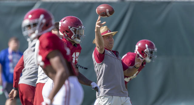 Alabama coach Nick Saban works with his players during the NCAA college football team's practice Wednesday, April 11, 2018, in Tuscaloosa, Ala. (Vasha Hunt/AL.com via AP)
