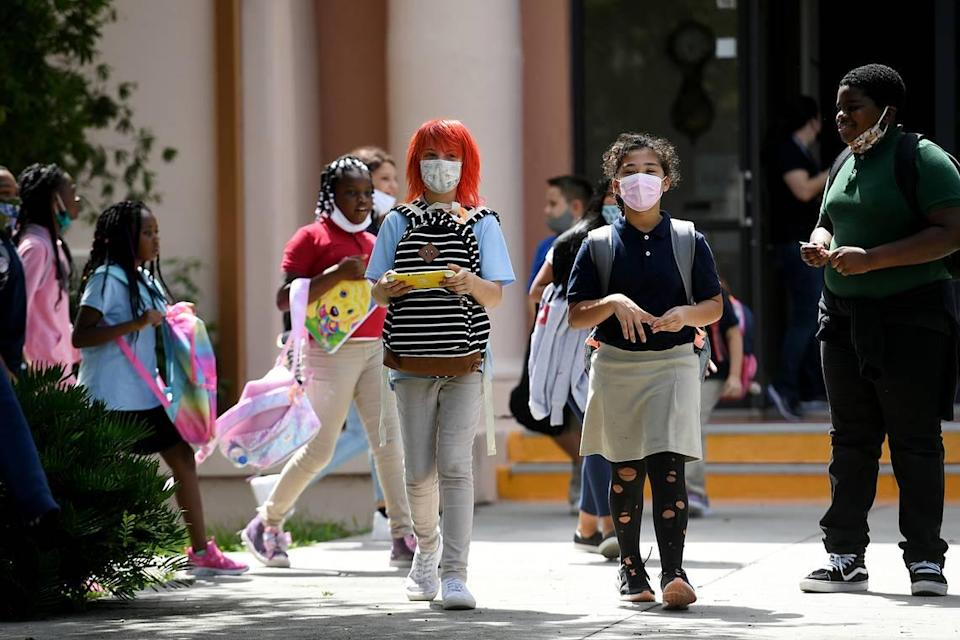 Students are dismissed from Ballard Elementary School on Wednesday, August 25, 2021, in Bradenton. More than 2,400 parents answered a school district survey and said they preferred a mask-only classroom for their children.