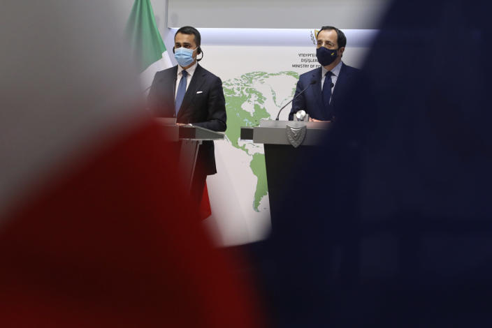 Cypriot Foreign Minister Nicos Christodoulides, right, and Italian Foreign Minister Luigi Di Maio take part in a press conference after their meeting at the Foreign Ministry house in Nicosia, Cyprus, Tuesday, March 9, 2021. Maio is in Cyprus on a one-day visit. (Yiannis Kourtoglou Pool via AP)