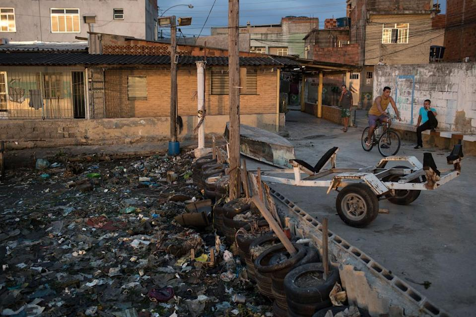 <p>Houses stand next to the heavily polluted shore of Guanabara Bay in Rio de Janeiro, Brazil, Saturday, July 30, 2016. Just days ahead of the Olympic Games the waterways of Rio are as filthy as ever, contaminated with raw human sewage teeming with dangerous viruses and bacteria, according to a 16-month-long study commissioned by The Associated Press. (AP Photo/Felipe Dana)</p>