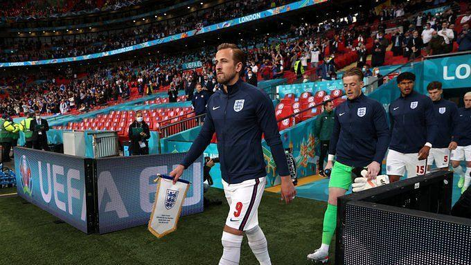 Harry Kane leads out the England team against Scotland.