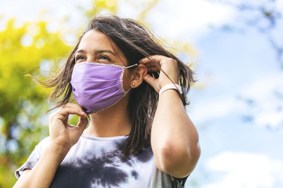 Support the Latinx community and do your part in limiting the spread of coronavirus by buying face masks from Latinx-owned Etsy shops. (eyecrave via Getty Images)