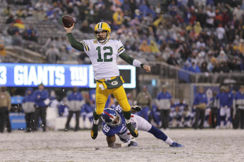 Green Bay Packers quarterback Aaron Rodgers throws a touchdown pass to Marcedes Lewis during the second half of an NFL football game against the New York Giants, Sunday, Dec. 1, 2019, in East Rutherford, N.J. (AP Photo/Adam Hunger)