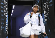 FILE - In this Jan. 22, 2020, file photo, Japan's Naomi Osaka walks into Margaret Court Arena for her second round singles match against China's Zheng Saisai at the Australian Open tennis tournament in Melbourne, Australia. Osaka has been selected by The Associated Press as the Female Athlete of the Year. (AP Photo/Andy Brownbill, File)