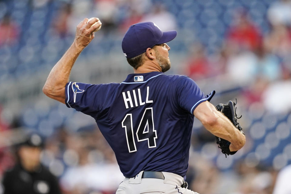 Tampa Bay Rays starting pitcher Rich Hill throws during the fourth inning of a baseball game against the Washington Nationals at Nationals Park, Tuesday, June 29, 2021, in Washington. (AP Photo/Alex Brandon)