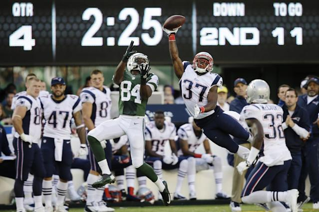 New England Patriots' Alfonzo Dennard (37) breaks up a pass to New York Jets' Stephen Hill (84) during the second half of an NFL football game Sunday, Oct. 20, 2013 in East Rutherford, N.J. (AP Photo/Seth Wenig)