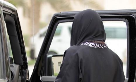 A Saudi woman gets into a car in Riyadh, Saudi Arabia. If this woman were to leave Saudi Arabia in that vehicle, her closest male relative would likely be alerted via text message.