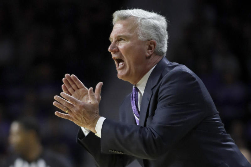 Kansas State head coach Bruce Weber applauds his team during the first half of an NCAA college basketball game against Texas in Manhattan, Kan., Saturday, Feb. 22, 2020. (AP Photo/Orlin Wagner)