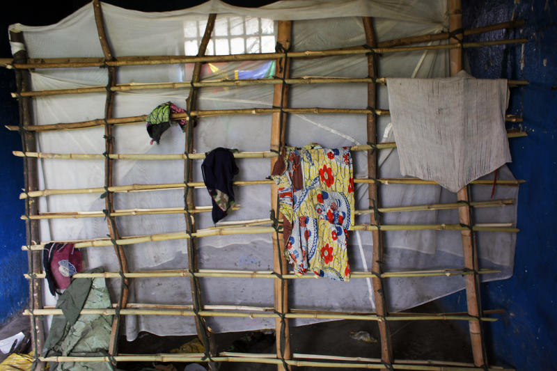 Clothes and a hand built net remain in a soldier's room in a colonial gable built for a battalion in eastern Congo's largest military camp in Rumangabo, some 40 kms (25 miles) north of Goma, Thursday Aug. 9, 2012. The camp, formally held by FARDC (the Forces Armees de la Republic Democratique du Congo) government troops, fell to M23 rebels late July. Most know that Congo's 150000-man army is hard done by, poorly and infrequently paid, badly provisioned and ill equipped on the armament front. What they left behind in the base shows they have no incentive to fight. The abandoned camp was home to at least 1000 government soldiers. The base was build by colonial Belgium. (AP Photo/Jerome Delay)