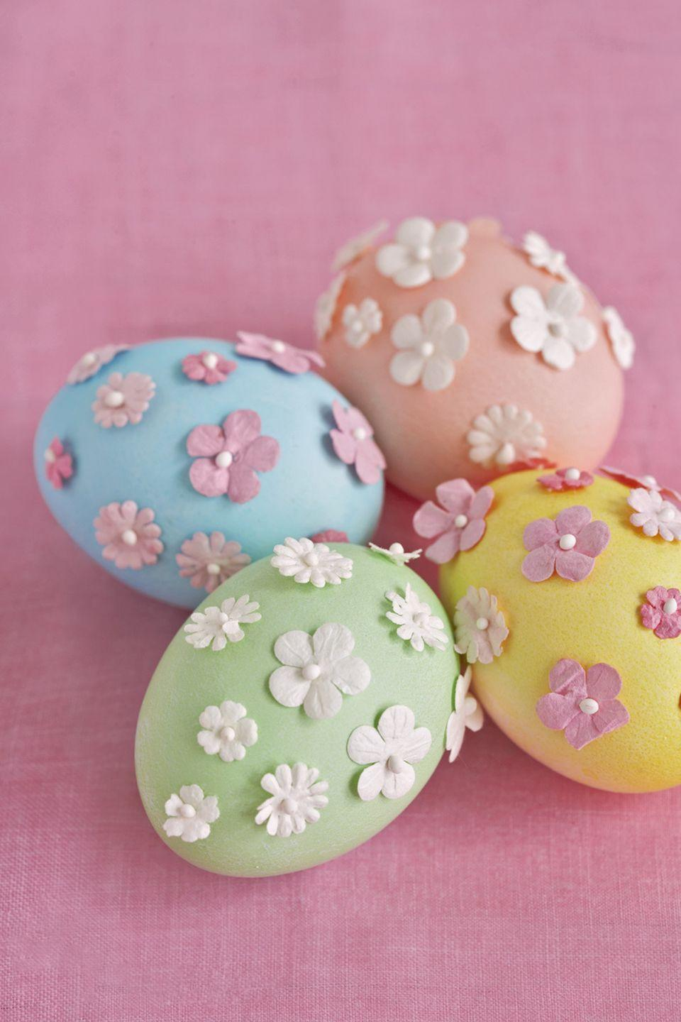 <p>Make these pastel beauties last for years by first blowing out the egg's whites and yolks.</p><p><strong>Step 1:</strong> Insert a long needle into the bottom of each egg; make a small hole, then make a slightly larger one in the top.</p><p><strong>Step 2:</strong> Move the needle around inside the shell to break the yolk.</p><p><strong>Step 3:</strong> Blow over the smaller hole—feel free to use a straw if you don't want to touch the egg directly—until the liquid drips out of the larger hole.</p><p><strong>Step 4:</strong> Run the egg under water. Blow the water out, and let the shell dry overnight.</p><p><strong>Step 5:</strong> After coloring the egg, attach fabric scrapbooking flowers with tiny dots of glue. Lightly press each flower with your finger, then release.</p>