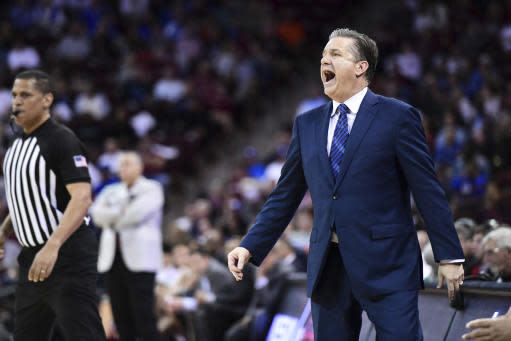 Kentucky coach John Calipari shouts to players during the second half the team's NCAA college basketball game against South Carolina on Wednesday, Jan. 15, 2020, in Columbia, S.C. South Carolina won 81-78. (AP Photo/Sean Rayford)