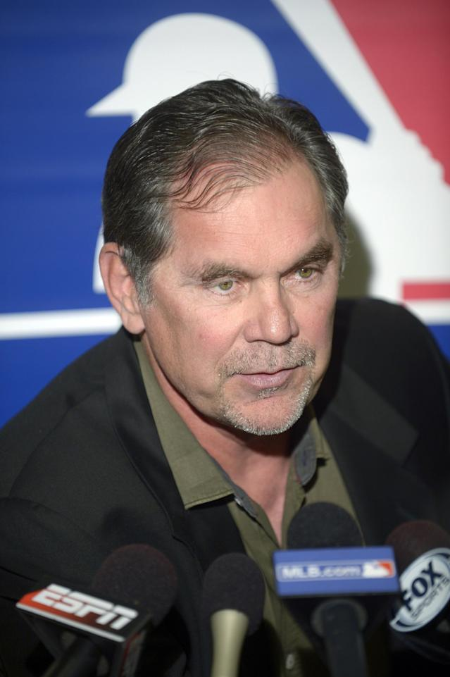 San Francisco Giants manager Bruce Bochy answers a question from a reporter during a media availability at baseball's winter meetings in Lake Buena Vista, Fla., Tuesday, Dec. 10, 2013.(AP Photo/Phelan M. Ebenhack)