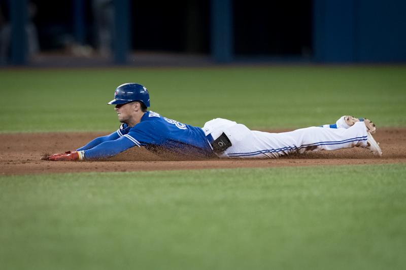 TORONTO, ON - SEPTEMBER 27: Toronto Blue Jays Infield Cavan Biggio (8) slides into second base safe during the sixth inning of the MLB regular season game between the Toronto Blue Jays and the Tampa Bay Rays on September 27, 2019, at Rogers Centre in Toronto, ON, Canada. (Photo by Julian Avram/Icon Sportswire via Getty Images)