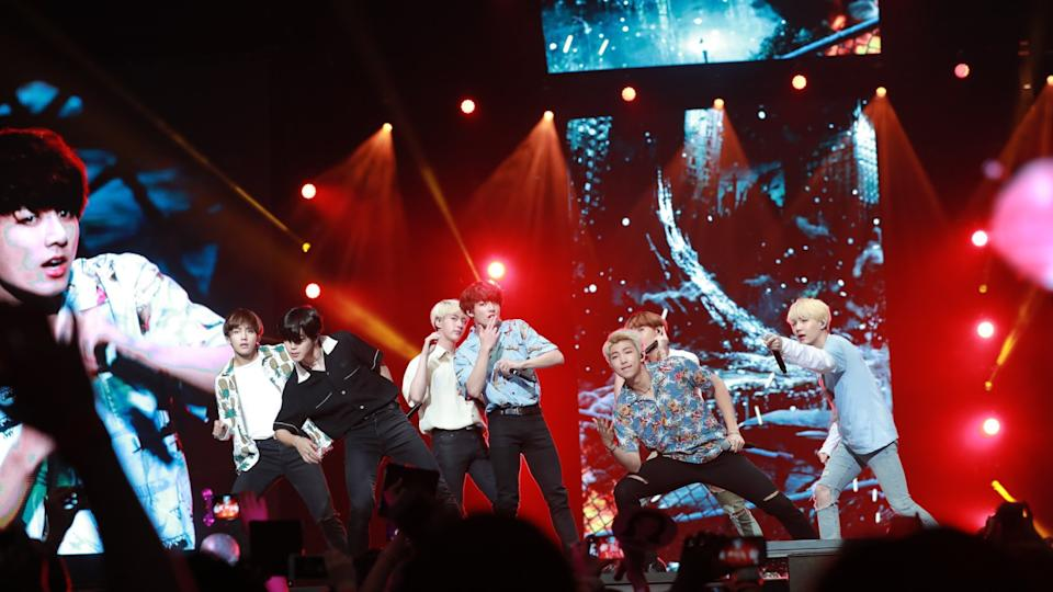 BTS shows off some of its choreography on stage at the Rose Bowl in Pasadena.