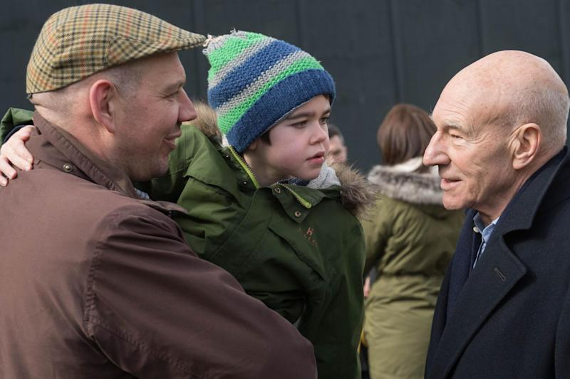 Six-year-old Alfie Dingley and his father Drew Dingley with Sir Patrick Stewart: PA Wire/PA Images