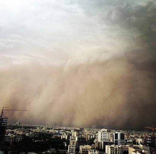 A picture taken with a smartphone shows a sandstorm engulfing Tehran on June 2, 2014