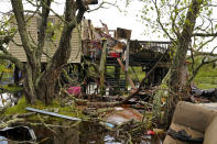A home is so damaged it will not be able to receive power once it is restored, in the aftermath of Hurricane Ida in Dulac, La., Friday, Sept. 17, 2021. (AP Photo/Gerald Herbert)