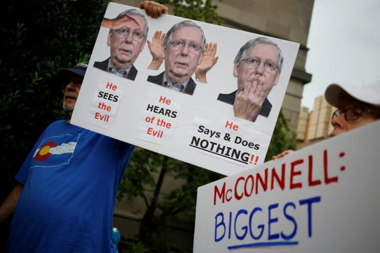 Activists in Louisville, Kentucky demonstrate for action on gun control outside the office of Senate Majority Leader Mitch McConnell on Tuesday following dealy shootings in El Paso, Texas and Dayton, Ohio (AFP Photo/LUKE SHARRETT)