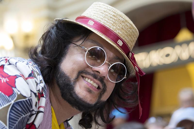 FILE - In this Tuesday, July 5, 2016, file photo, Russian pop singer Filipp Kirkorov smiles at the GUM Department store in Red Square, Moscow, Russia. French composer Didier Marouani and his Russian lawyer Igor Trunov have been detained Tuesday, Nov. 29, 2016, and spent a night in a Moscow police station after Russian pop star Filipp Kirkorov has accused them of extorting 1 million euros from him in a plagiarism row. (AP Photo/Alexander Zemlianichenko, File)