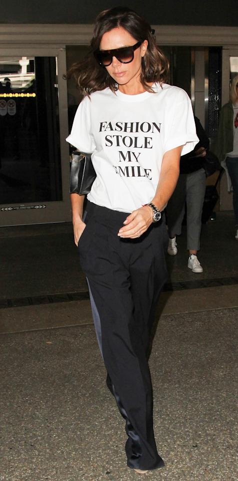 "<p><em>InStyle</em>'s April cover star stepped out at LAX in the most Victoria Beckham-esque message tee we've ever seen (it is, of course, her own design), reading ""Fashion Stole My Smile"" in block letters ($150; <a rel=""nofollow"" href=""https://www.victoriabeckham.com/us/victoria-victoria-beckham/pre-aw17-jyvv-058-white-black-print.html"">victoriabeckham.com</a>), which she paired with a set of chic black track pants and her boxy signature shades.</p>"