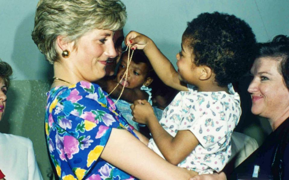 Diana, the Princess of Wales, hugs an HIV positive baby in Sao Paulo, Brazil, in April 1991 - Dave Caulkin/AP