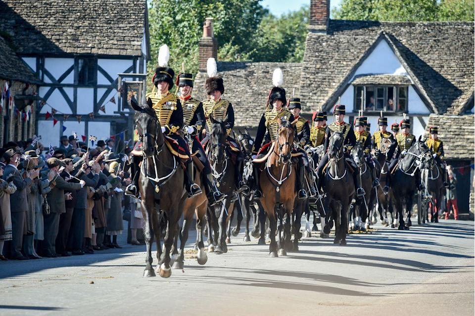 <p>Here's a large crowd scene of what appears to be a parade in the village of Downton.</p>