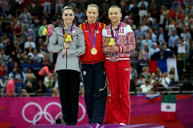 <p>Silver medallist McKayla Maroney Maroney (L) of the United States, gold medallist Sandra Raluca Izbasa (C) of Romania and bronze medallist Maria Paseka of Russia pose with their medals during the medal ceremony following the Artistic Gymnastics Women's Vault final on Day 9 of the London 2012 Olympic Games at North Greenwich Arena on August 5, 2012 in London, England. (Photo by Ronald Martinez/Getty Images) </p>