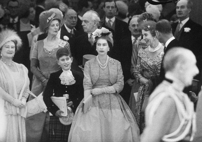 Not published in LIFE. Queen Elizabeth with Prince Charles and Elizabeth II at Princess Margaret's wedding, 1960.  Click here to see the full collection at LIFE.com…