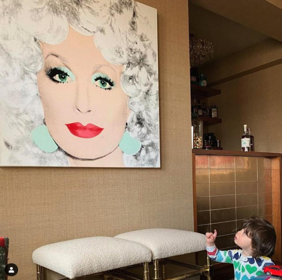 Andy Cohen's son looking at Dolly Parton painting
