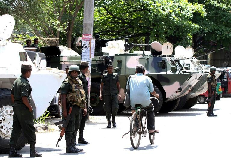 Armoured vehicles and heavily-armed troops guard Kandy, the epicentre of the violence