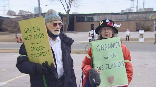 Protesters Douglas Buck and Kate Chung say they want the TRCA to impose conditions at its hearing on Friday that will stop the development on the wetlands entirely.