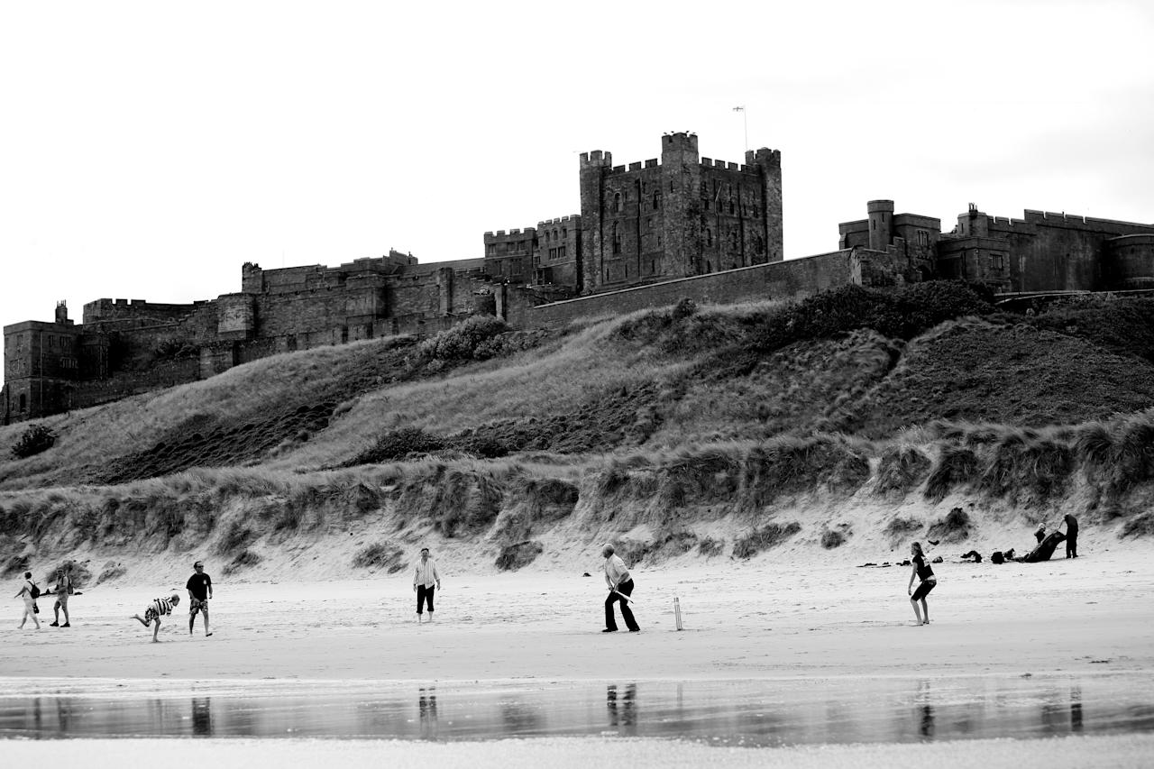 BAMBURGH, ENGLAND - JULY 13: A family play an impromptu game of beach cricket at the foot of Bamburgh on July 13, 2008 in Bamburgh, England. (Photo by Laurence Griffiths/Getty Images)