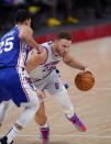 Detroit Pistons forward Blake Griffin (23) drives on Philadelphia 76ers guard Ben Simmons (25) during the second half of an NBA basketball game, Monday, Jan. 25, 2021, in Detroit. (AP Photo/Carlos Osorio)